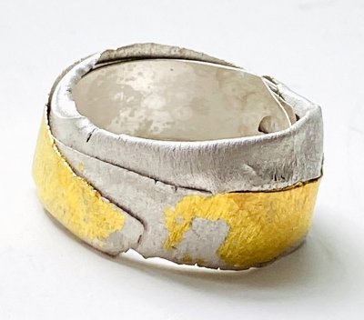 Twisted silver ring with gold leaf